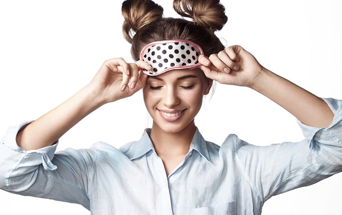 Girl is preparing to sleep with a night mask