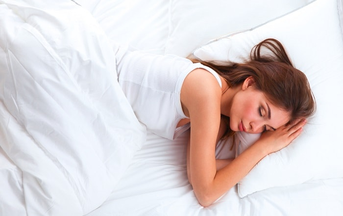 Girl sleeping soundly on latex mattress