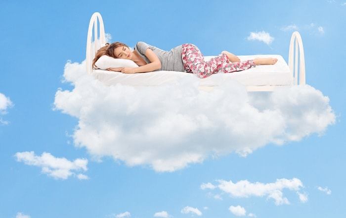 Girl sleeping peacefully on a cloud mattress